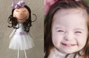 Down sendromlu kızının gülüşünü oyuncak bebeklere...