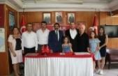 Antalya Kepez'de İP'den istifa eden 20 kişi MHP'ye geçti
