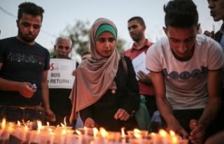 Gazze şehitleri anısına mum yakıp İsrail'i...
