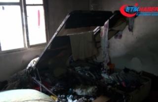 Evini ateşe verdi, bebeğini komşular kurtardı