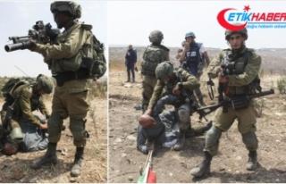 İsrail askerlerinin Filistinli yaşlı adama uyguladığı...