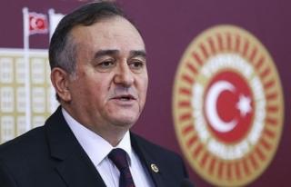 MHP'li Erkan Akçay, CHP'li Özgür Özel'i...