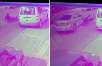 Bisiklet sürücüsünün otomobilin altında kaldığı an kamerada