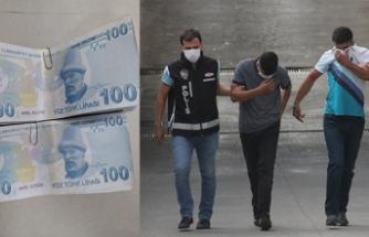 Sahte parayla cep telefonu satın alan iki zanlı tutuklandı