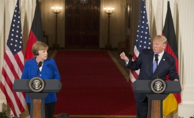 Zirve öncesi Trump'la Merkel arasında söz savaşı