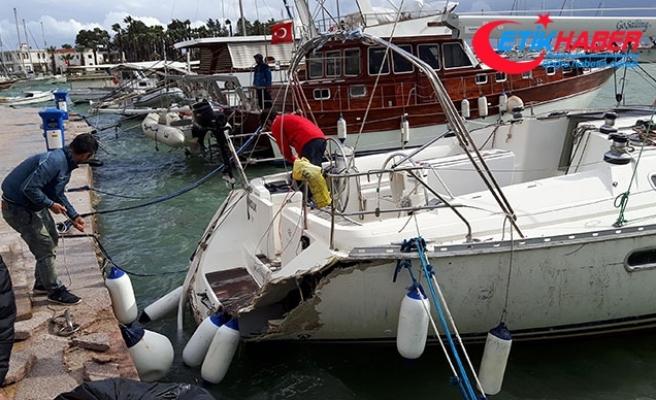 Limanda demirli tekne, fırtınada beton rıhtıma çarptı