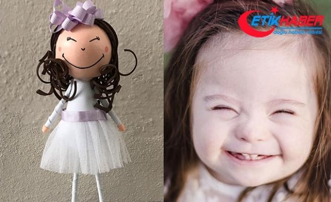 Down sendromlu kızının gülüşünü oyuncak bebeklere taşıdı